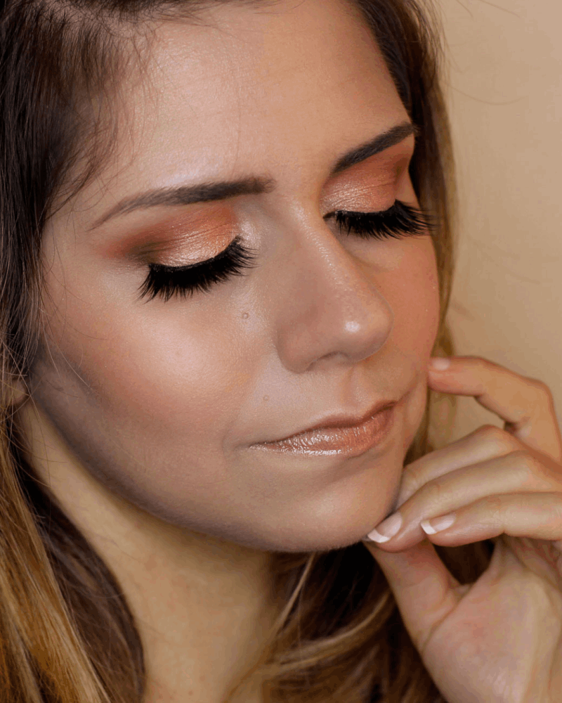 frankiefrancy peachy makeup with natural lips and false lashes